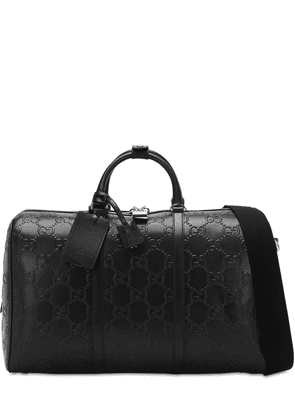 Gg Debossed Leather Duffle Bag