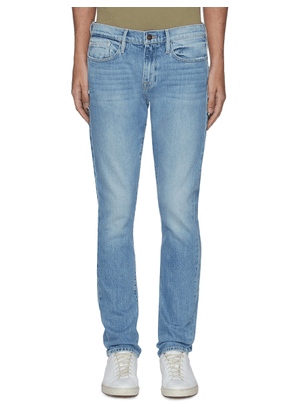 L'Homme mid wash whiskering jeans