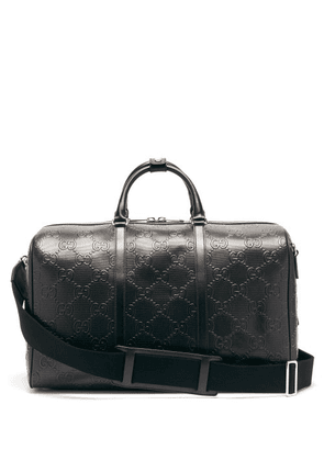 Gucci - GG-monogram Perforated-leather Holdall - Mens - Black