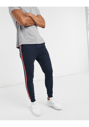 ASOS DESIGN skinny joggers with side stripe in navy