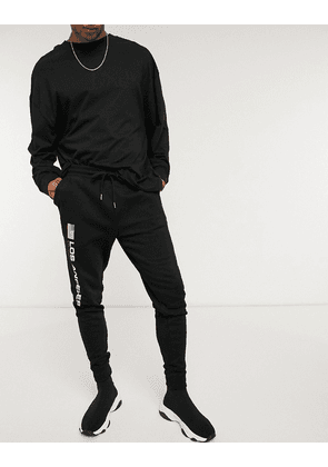 ASOS DESIGN skinny joggers with Los Angeles flag print-Black