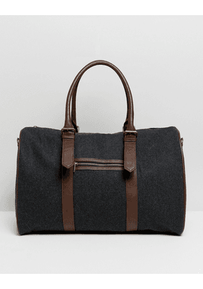 ASOS DESIGN holdall in dark grey fabric with tan straps