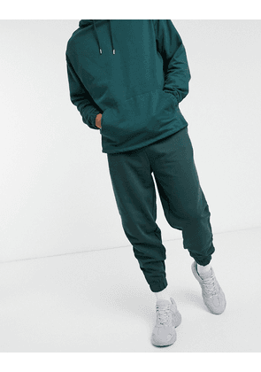 ASOS DESIGN co-ord organic oversized joggers in green