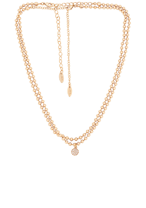 Ettika Ball Necklace with Crystal Ball Accent in Metallic Gold.