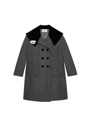Wool coat with floral brooch