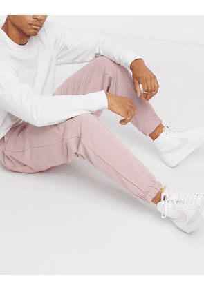 ASOS DESIGN oversized joggers in pink-Purple