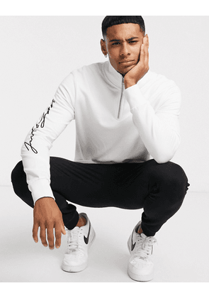Jack & Jones quarter zip sweat scripted text-White