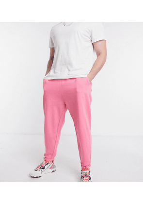 ASOS DESIGN Plus co-ord oversized jogger in bright pink