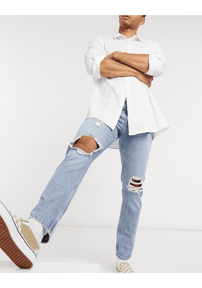 ASOS DESIGN slim jeans in vintage light wash with knee rips-Blue