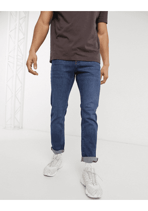 ASOS DESIGN stretch slim jeans in mid wash blue
