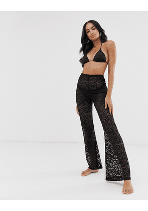 ASOS DESIGN beach flare trousers in animal jersey mesh-Black