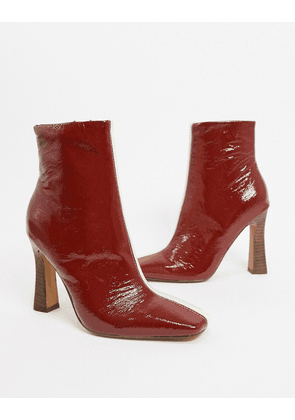 ASOS DESIGN Elka premium leather boots in white and burgundy mix