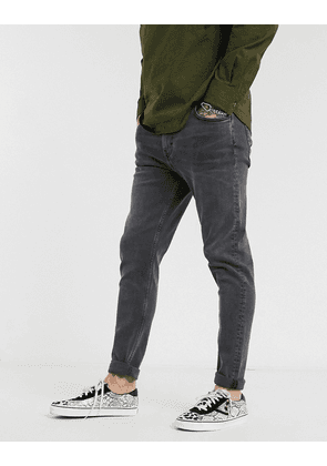 Weekday Cone tapered jeans in black