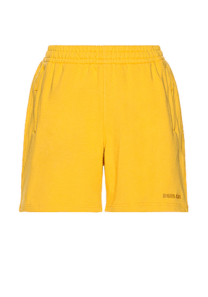 adidas x Pharrell Williams Basics Short in Bold Gold - Yellow. Size XL (also in ).