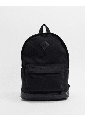 ASOS DESIGN backpack in black canvas and faux leather