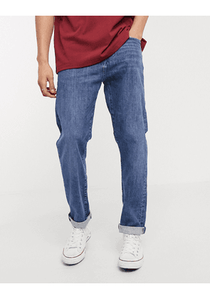 Edwin ED45 tapered fit jeans in washed blue denim
