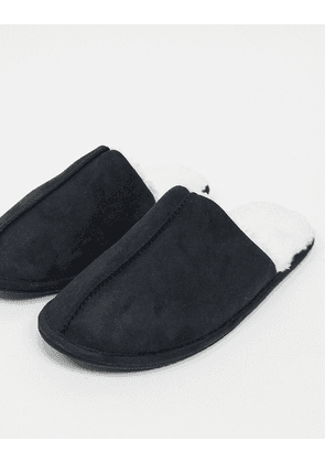 ASOS DESIGN slip on slippers in black with cream faux fur lining