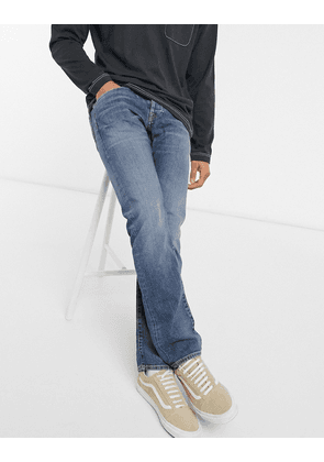 Edwin ED55 regular tapered fit jeans in washed blue denim-Black