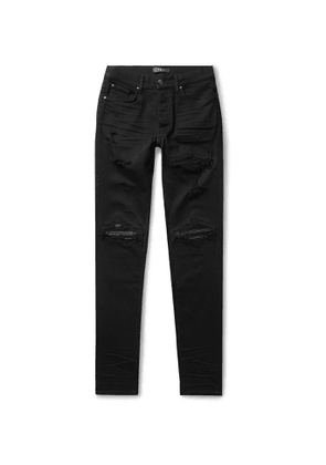 AMIRI - MX1 Skinny-Fit Distressed Leather-Panelled Stretch-Denim Jeans - Men - Black