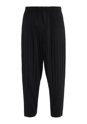 Homme Plissé Issey Miyake - Tapered Technical-pleated Trousers - Mens - Black