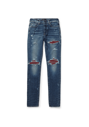 AMIRI - MX1 Ultra Skinny-Fit Distressed Panelled Stretch-Denim Jeans - Men - Blue