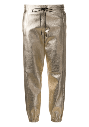 Saint Laurent metallic track pants - Gold