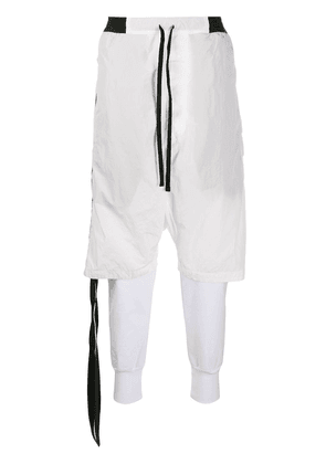 UNRAVEL PROJECT layered drop-crotch track trousers - White
