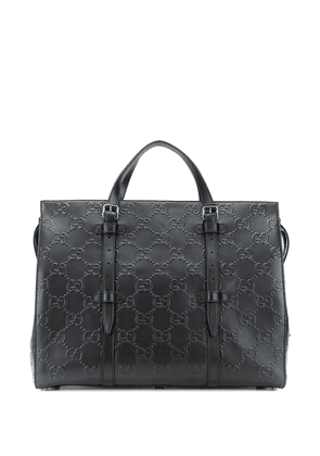 Gucci leather debossed GG holdall bag - Black