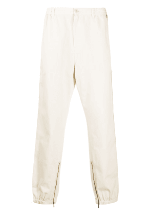 Gucci side-stripe tapered-leg trousers - White