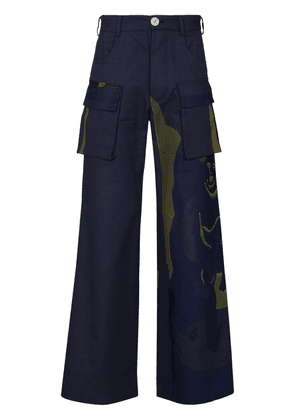 Bethany Williams camouflage-print wide-leg trousers - Blue