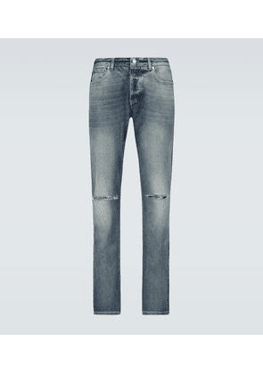 Distressed slim-fit denim jeans