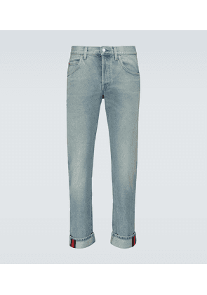 Tapered denim pants with Web