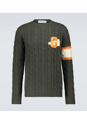 Cable knitted wool sweater