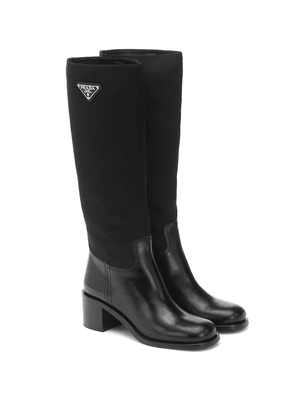 Nylon and leather knee-high boots