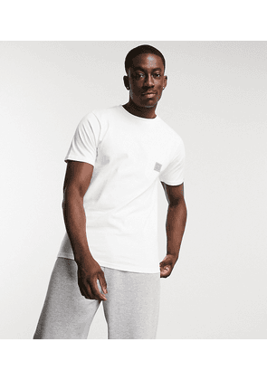 Ellesse pocket t-shirt in white exclusive to ASOS