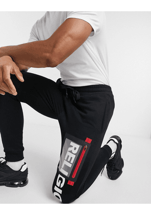 Religion patch detail logo joggers in black