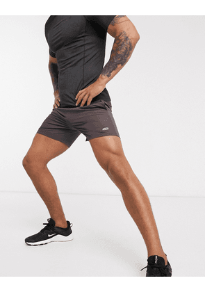ASOS 4505 icon training shorts in mid length with quick dry in brown