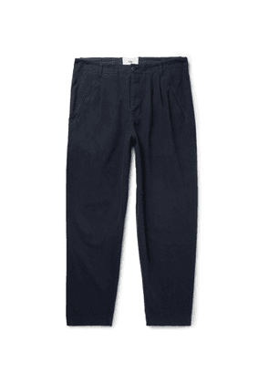 Folk - Navy Assembly Tapered Pleated Cotton-Canvas Trousers - Men - Blue