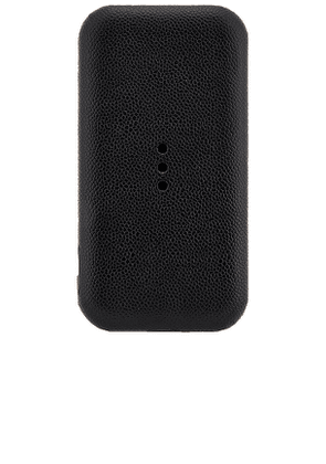 Courant Carry Portable Wireless Charger in Black.