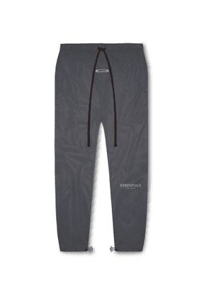 Fear of God Essentials - Tapered Logo-Print Reflective Shell Track Pants - Men - Black
