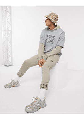 ASOS 4505 tapered joggers in beige-Brown