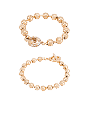 Ettika Bead Bracelet Set in Metallic Gold.