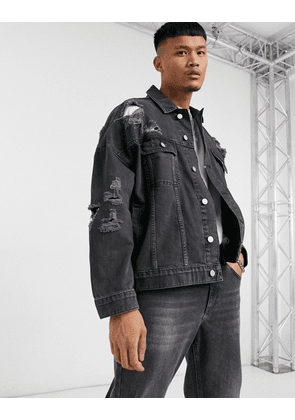 ASOS DESIGN oversized denim jacket with rips in washed black