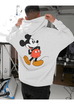 ASOS DESIGN oversized hoodie in white marl with Mickey Mouse back print
