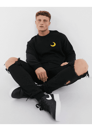 ASOS DESIGN knitted jumper with embroidered moon in black