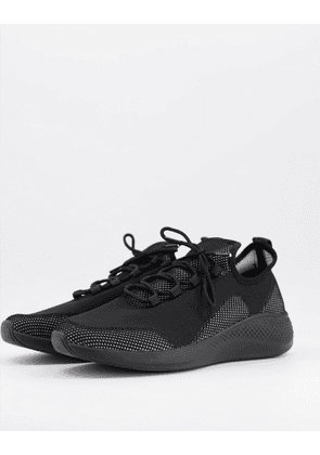 ASOS DESIGN knitted runner trainers in black