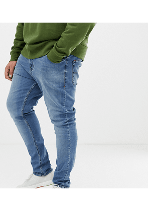 COLLUSION Plus x001 skinny jeans in blue mid wash