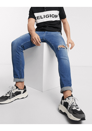 Religion Vicious skinny fit jeans with abrasions in mid wash-Blue