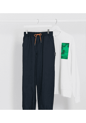 COLLUSION nylon trousers in navy