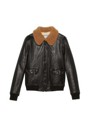 Leather jacket with shearling